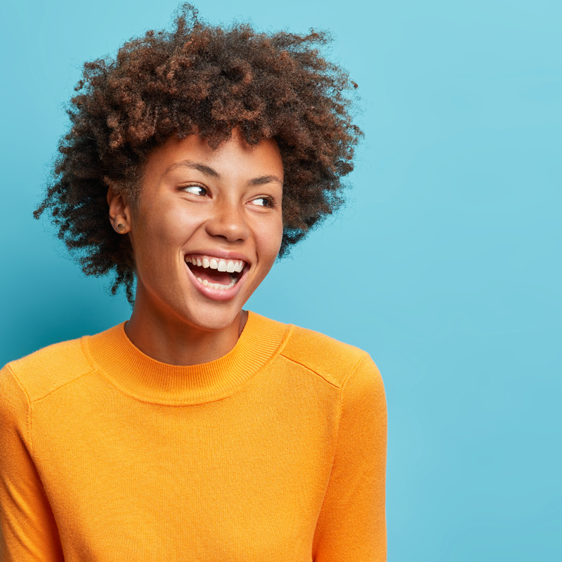 Image: Young woman smiling and excited about life